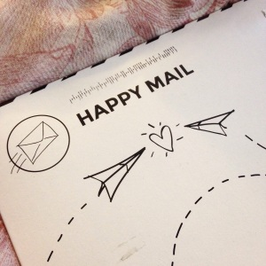 A Beautiful Mess Happy Mail envelope cardboard mailer